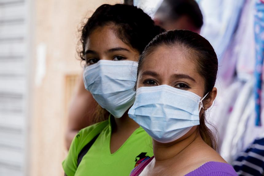 Two women wearing face masks